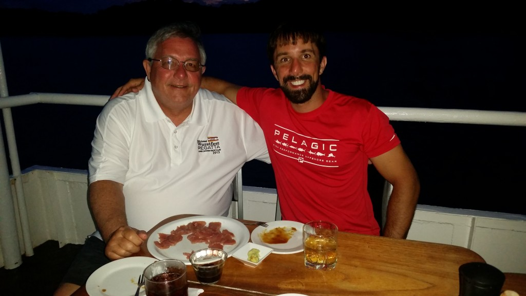My dad and I enjoying fresh yellow-fin tuna sashimi aboard the mother ship.