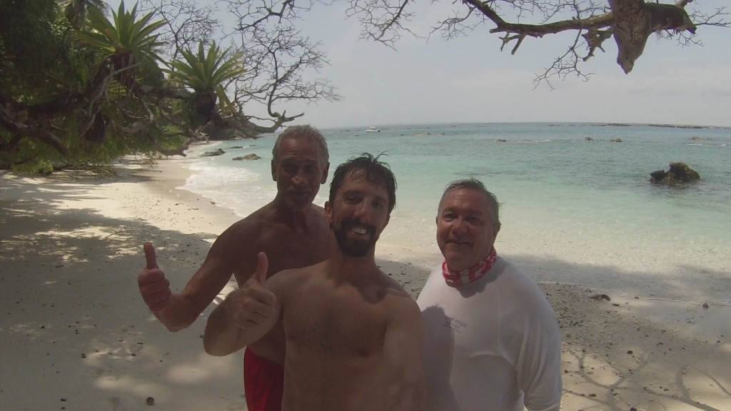 Owner Mike, my dad, and I taking a lunch break from fishing on a white sand beach.