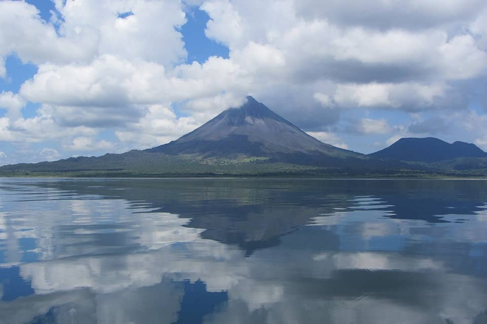 Arenal Volcano reflecting over Lake Arenal, Costa Rica